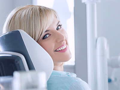 women smiling in dental exam chair
