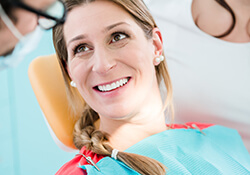 Women in pink smiling at dentist